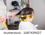 a woman wearing a perm | Shutterstock . vector #1087439027