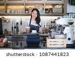asian women barista smiling  in ... | Shutterstock . vector #1087441823