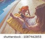 girl using cellphone near the... | Shutterstock . vector #1087462853