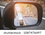 rural car driving on the... | Shutterstock . vector #1087476497