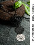 Small photo of vintage women's accessory on dahunpao tea briquette and leaves