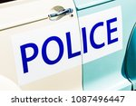large police sign on the side... | Shutterstock . vector #1087496447