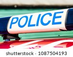 police sign with blue lights on ... | Shutterstock . vector #1087504193