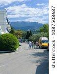 Small photo of Yalta, Crimea / Ukraine - July 7, 2007: People walking at streets of Yalta, Crimea
