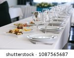 a row of crystal glasses and... | Shutterstock . vector #1087565687