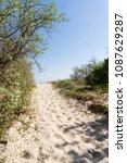 sandy path to the beach between ... | Shutterstock . vector #1087629287