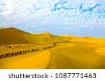 camel caravan ride in desert... | Shutterstock . vector #1087771463