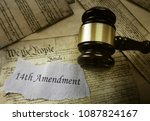 Small photo of 14th Amendment news headline on pages of the US Consitution