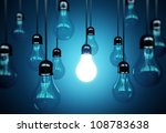 idea concept with light bulbs on a blue background - stock photo
