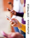 closeup of group young people using smart phone - stock photo