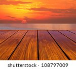 wood terrace perspective and sun set - stock photo