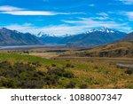 a stream flows through a plain... | Shutterstock . vector #1088007347