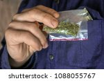 man shows a packet with a spice ... | Shutterstock . vector #1088055767