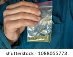man shows a packet with a spice ... | Shutterstock . vector #1088055773