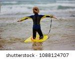 little girl surfer waiting for... | Shutterstock . vector #1088124707