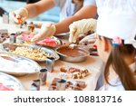 Young girl making chocolate candy - stock photo