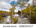 man in black jacket walking to...   Shutterstock . vector #1088205317
