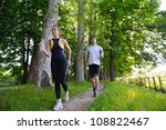 young couple jogging in park at ... | Shutterstock . vector #108822467