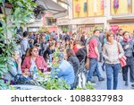 unidentified people sit a cafe... | Shutterstock . vector #1088337983