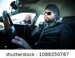 portrait of man in his car....   Shutterstock . vector #1088350787