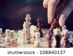 woman playing chess and hold... | Shutterstock . vector #108840137