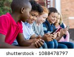 pupils using mobile phone at... | Shutterstock . vector #1088478797