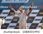 Small photo of May 06, 2018 - Lexington, Ohio, USA: Hello Castroneves (BRA) is showered with champagne from his fellow racers after winning the Acura Sports Car Challenge at Mid Ohio in Lexington, Ohio.
