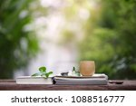 brown vintage cup with books at ... | Shutterstock . vector #1088516777