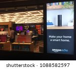 Small photo of NEW YORK- MAY 2018: Black Amazon Echo , Alexa Voice Service activated recognition system advertised outside Amazon book store. E-commerce biz sells Kindles, Fire TV tablet Alexa Echo AMZN smart home