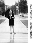 woman with umbrella | Shutterstock . vector #108859493