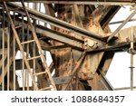 grunge old crane rusts on harbor | Shutterstock . vector #1088684357