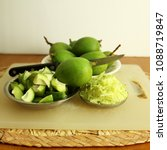 Small photo of green mango for indian traditional homemade Mango Pickle or Aam Achar