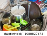 dirty dishes in the sink in the ... | Shutterstock . vector #1088827673