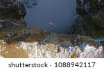aerial shot of the man jumping... | Shutterstock . vector #1088942117