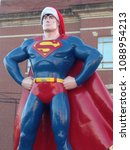 Small photo of Metropolis, IL / USA - December 15, 2015: A 15-foot-tell bronze statue of Superman is decked out and ready for Christmas in Metropolis, IL, official hometown of the Man of Steel.