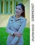 Small photo of Thai Female servant in khaki uniform, Government officials in uniform