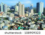 Aerial view on Makati - is one of the 17 cities that make up Metro Manila. Philippines - stock photo