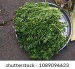 green herbs in a silver plate... | Shutterstock . vector #1089096623