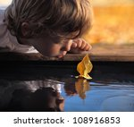 leaf ship in children hand | Shutterstock . vector #108916853