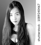 Small photo of portrait in black and white of a sultry young woman