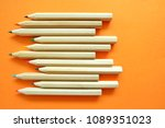 pencils on orange background. | Shutterstock . vector #1089351023