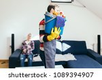 handsome husband cleaning house ... | Shutterstock . vector #1089394907