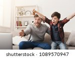 father and son watching... | Shutterstock . vector #1089570947