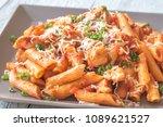 portion of cheesy chicken pasta | Shutterstock . vector #1089621527