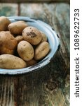 full bowl of raw potato on a... | Shutterstock . vector #1089622733