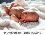 newborn baby sleeping on white... | Shutterstock . vector #1089706343
