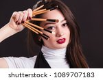 makeup artist with brushes in... | Shutterstock . vector #1089707183