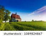 old church in the summer field. ...   Shutterstock . vector #1089824867
