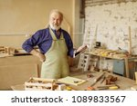 Small photo of close up portrait of cheerful senior citizen chatting with clients. talking with customers. doing shopping online. internet is main helper for carpenter