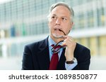 mature businessman portrait... | Shutterstock . vector #1089850877
